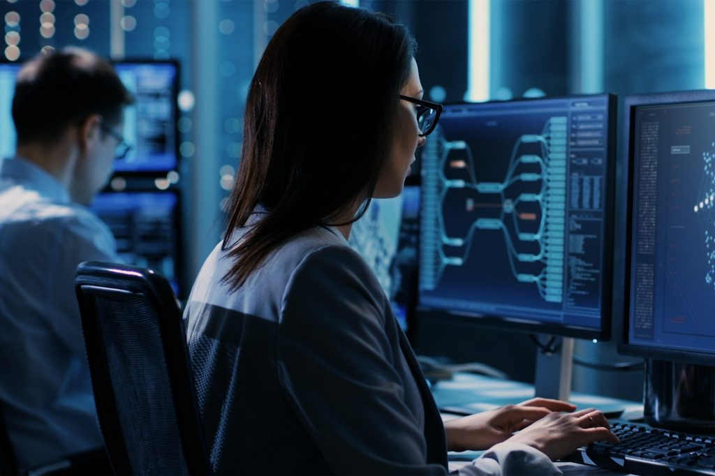 woman sitting at desk working counterintelligence jobs