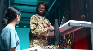 Female Network Engineers Using Laptop in Server Room